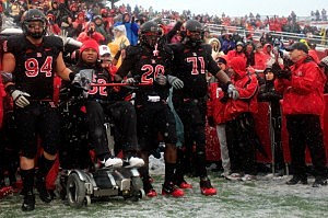 Former Rutgers football player Eric LeGrand  leads the Rutgers Scarlet Knights onto the field