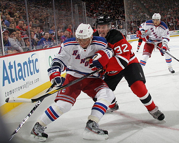 Matt Taormina #32 of the New Jersey Devils checks Marian Gaborik #10 of the New York Rangers