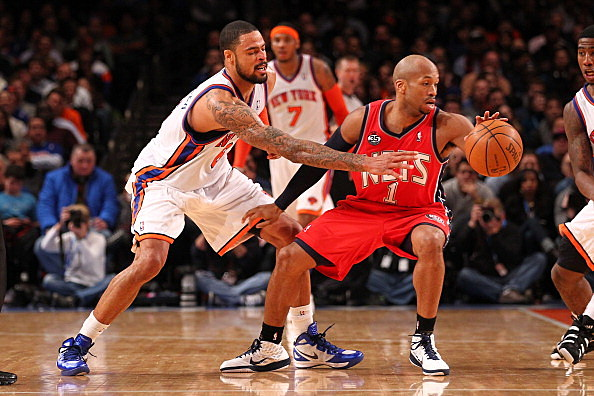 Tyson Chandler #6 of the New York Knicks defends against Sundiata Gaines #1 of the New Jersey Nets  during their pre season game  at Madison Square Garden
