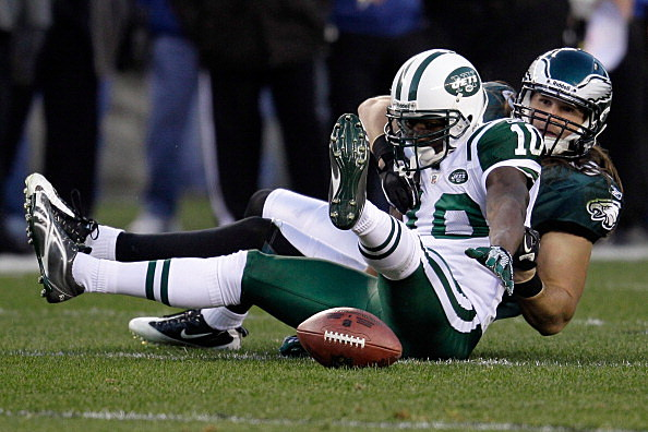 Casey Matthews #50 of the Philadelphia Eagles and  Santonio Holmes #10 of the New York Jets