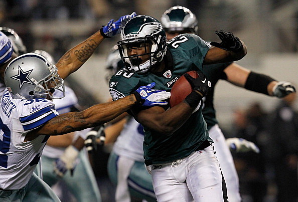 Running back LeSean McCoy #25 of the Philadelphia Eagles carries the ball against cornerback Orlando Scandrick #32 of the Dallas Cowboys