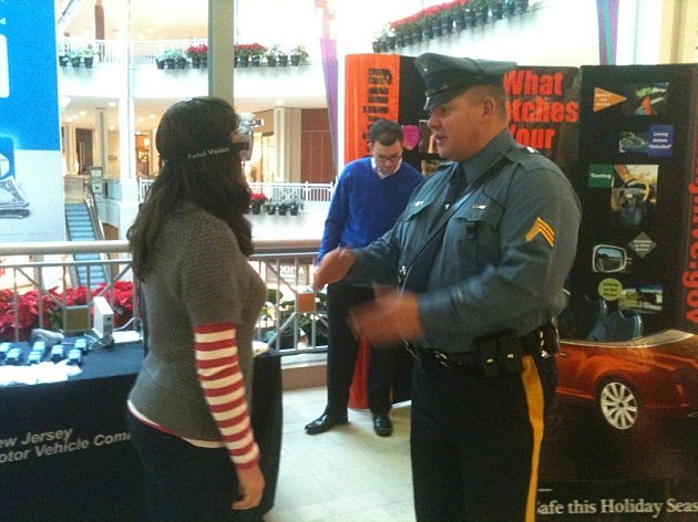 A NJ State Trooper conducts a simulated drunk driving field test at the Bridgewater Commons mall