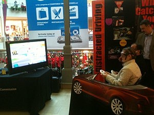 Shoppers at the Bridgewater Commons Mall test their driving skills