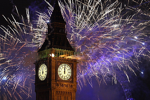 Fireworks light up the London skyline and Big Ben just after midnight