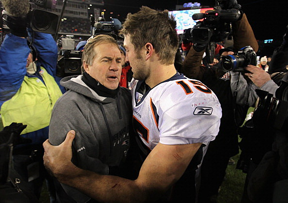 Tim Tebow #15 (R) of the Denver Broncos congraulates head coach Bill Belichick of the New England Patriots after the Patriots playoff win over Denver