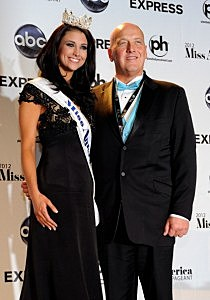 Laura Kaeppeler (L), Miss Wisconsin, poses with her father Jeff Kaeppeler during a news conference after she was named the new Miss America