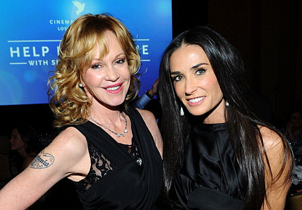 Melanie Griffith (L) and Demi Moore