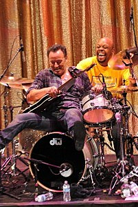 Bruce Springsteen (L) sits on drummer Joffo Simmons drum