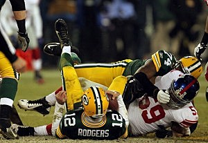 Aaron Rodgers #12 of the Green Bay Packers gets sacked by Michael Boley #59 of the New York Giants in the fourth quarter