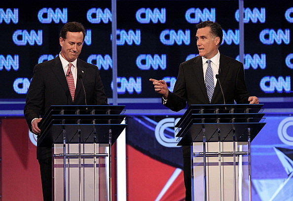 Rick Santorum (L) and Mitt Romney at South  Carolina GOP Debate