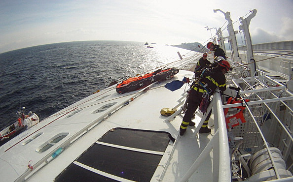 Firefighters work on the cruise ship Costa Concordia