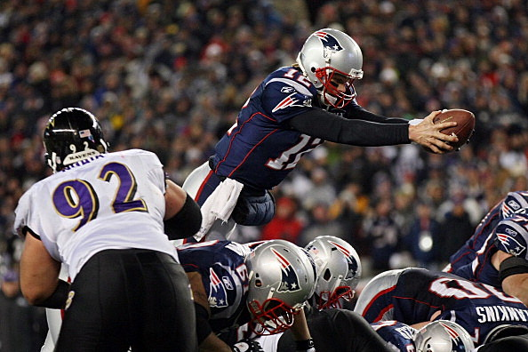 Tom Brady #12 of the New England Patriots dives into the end zone to score a touchdown in the fourth quarter