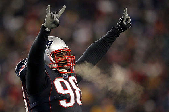 Gerard Warren #98 of the New England Patriots celebrates after defeating the Baltimore Ravens in the AFC Championship Game