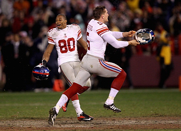 (L-R) Victor Cruz #80 and Steve Weatherford #5 of the New York Giants celebrate after they won 20-17 in overtime against the San Francisco 49ers