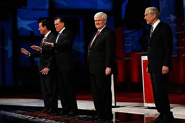 Republican presidential candidates former U.S. Sen. Rick Santorum, former Massachusetts Gov. Mitt Romney, former Speaker of the House Newt Gingrich (R-GA) and U.S. Rep. Ron Paul (R-TX) appear before the NBC News, National Journal, Tampa Bay Times GOP debate held at the University of South Florida