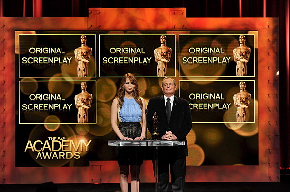 Jennifer Lawrence (L) and Academy of Motion Picture Arts and Sciences President Tom Sherak announce the 84th Academy Awards nominations
