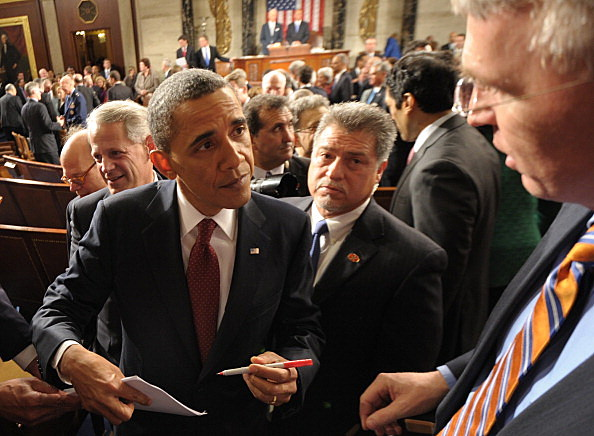 President Barack Obama signs autographs following the State of the Union address