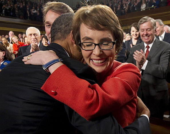 President Barack Obama embraces U.S. Rep. Gabrielle Giffords (D-AZ)