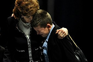 Sue Paterno, widow of Joe Paterno, consoles her grandson