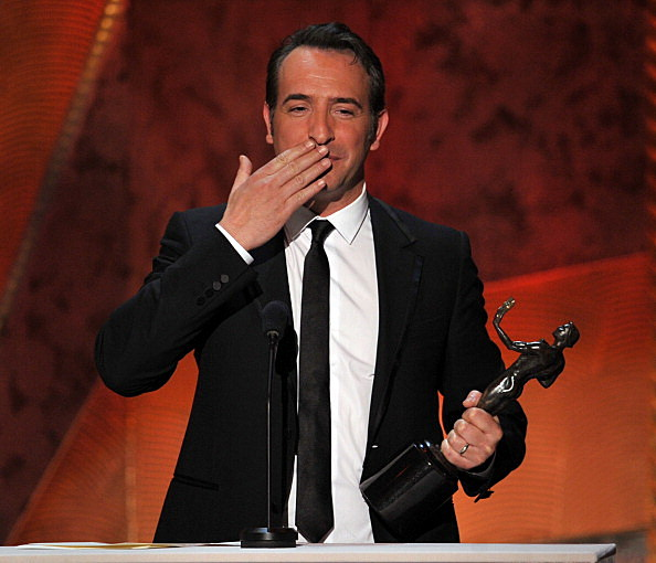 Actor Jean Dujardin accepts the Outstanding Performance by a Male Actor in a Leading Role award for 'The Artist'