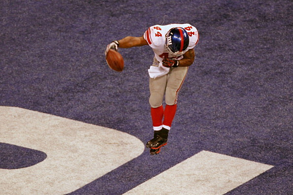 Ahmad Bradshaw #44 of the New York Giants celebrates his six-yard touchdown run in the fourth quarter
