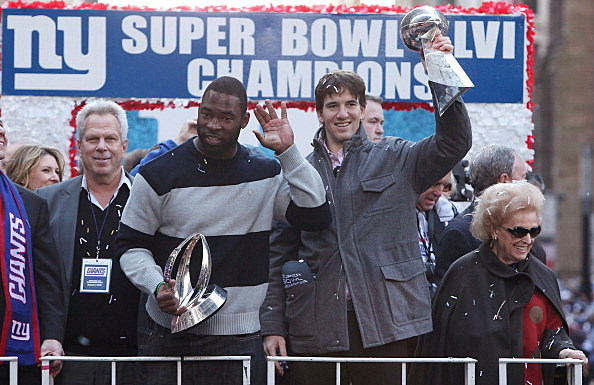 Co-owner of theGiants Steve Tisch, Justin Tuck and Eli Manning #10 at New York's City Hall Plaza