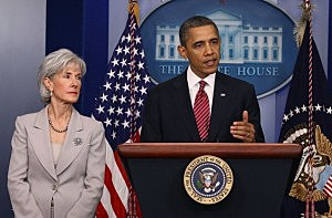 President Barack Obama (R) is joined by Health and Human Services Secretary Kathleen Sebelius