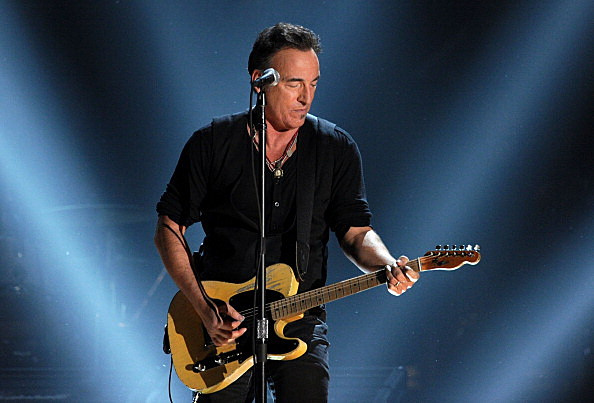 ruce Springsteen performs onstage at the 54th Annual Grammy Awards