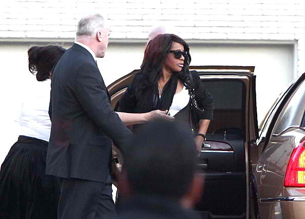 Bobbi Kristina Brown arrives at her mother's funeral