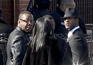 Bobby Brown (L) stands outside prior to the funeral services for Whitney Houston at the New Hope Baptist Church