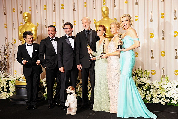 -R)  Producer Thomas Langmann, actor Jean Dujardin, director Michel Hazanavicius, actors James Cromwell, Berenice Bejo, Uggie the dog, Penelope Ann Miller, and Missi Pyle
