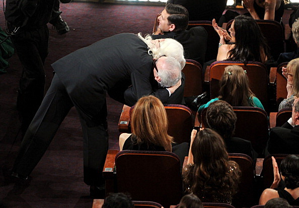 Cinematographer Robert Richardson hugs director Martin Scorsese