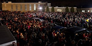 Students and those in the community embrace one another as they hold a candlelight vigil  in Chadron, Ohio