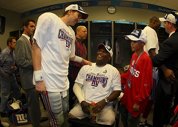 Eli Manning with U.S. Army Lt. Col. Greg Gadson (C) and son Jalen after Giants beat Patriots in Super Bowl XLII