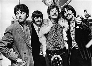 The Beatles celebrate the completion of their new album, 'Sgt Pepper's Lonely Hearts Club Band', at a press conference held at the west London home of their manager Brian Epstein.
