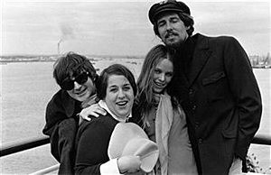 American popular singing group 'The Mamas and the Papas' arrive at Southampton, England. From l to r; Canadian-born Denny Doherty, Mama Cass Elliot (1941 - 1974), Michelle Phillips, and John Phillips