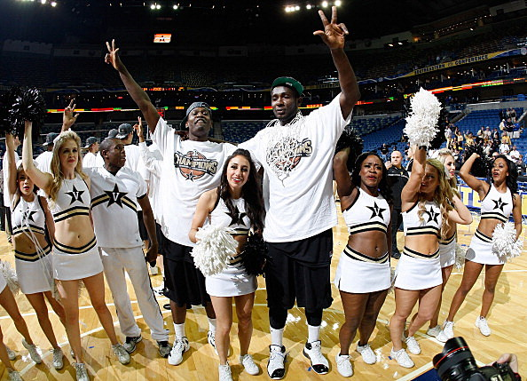 Festus Ezeli #3 and James Siakam #35 of the Vanderbilt Commodores celebrate their 71 to 64 win over the Kentucky Wildcats with cheerleaders after the championship game of the 2012 SEC Men's Basketball Tournament at New Orleans Arena