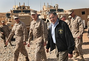 Secretary of Defense Leon Panetta (R) visits with troops March 14, 2012 at Forward Operating Base Shukvani, Afghanistan