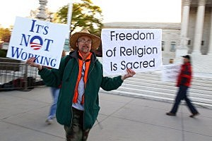 Protester outside Supreme Court building
