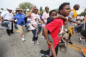 Trayvon Martin suppoters march in Sanford, Florida