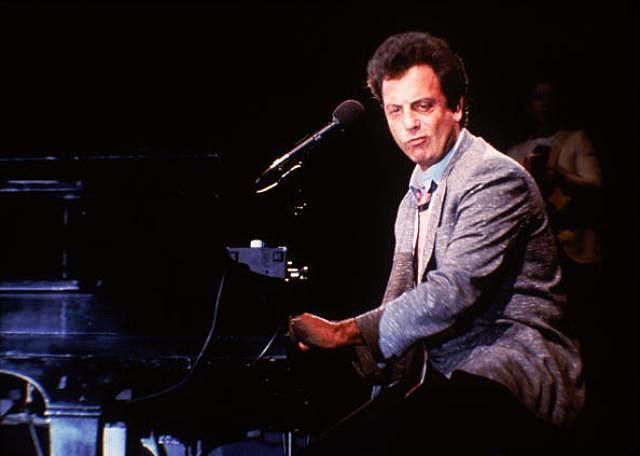 American singer-songwriter Billy Joel in concert in Wembley Arena, June 1984.