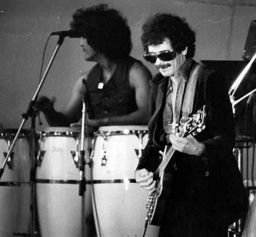 Mexican-born guitarist Carlos Santana on stage with his band Santana at the tenth 'Garden Party' at Crystal Palace Bowl, London.