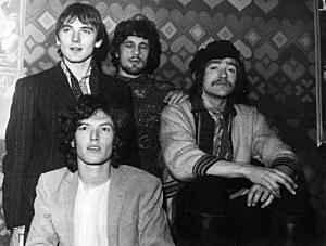 1968: British experimental psychedelic rock group Traffic, with founder member, the young multi-instrumentalist Stevie Winwood, sitting in the foreground, with Chris Wood, Jim Capaldi and Dave Mason behind.