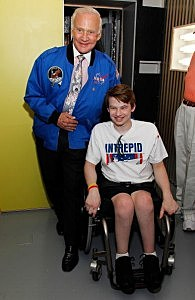 Buzz Aldrin poses for a photo with Sawyer Rosenstein from Ramsey at Intrepid Sea-Air-Space Museum in New York (Photo by Joe Kohen/Getty Images for Intrepid Museum)