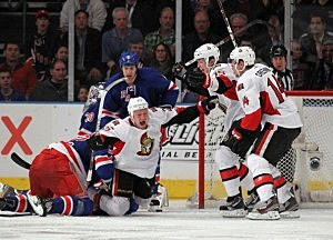 Chris Neil #25 of the Ottawa Senators scores the overtime winning goal at 1:17 of overtime against the New York Rangers