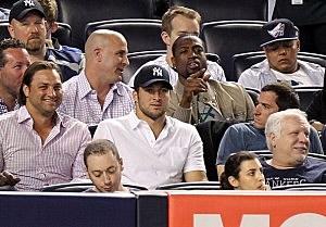 Jet quarterback Tim Tebow and Miami Heat's Dwyane Wade at Yankee Stadium