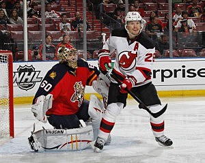 Patrik Elias #26 of the New Jersey Devils positions himself in front of goaltender Jose Theodore #60