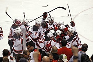 The New Jersey Devils celebrate their double overtime win against the Florida Panthers