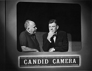 Allen Funt (L) and Arthur Godfrey on Candid Camera in 1961.