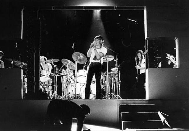 Rock group Pink Floyd rehearsing at Earls Court, prior to a concert. Singer Roger Waters wears headphones at the front of the stage.
